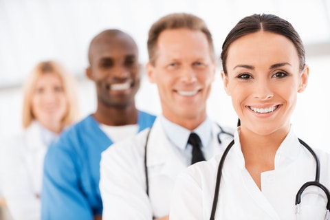 doctor, smiling, group, medical, leadership, ethnicity, standing, background, uniform, care, crowd, on, row, surgeon, practitioner, adult, out, people, skill, black, female, 11 Cities with Most Doctors per Capita in America