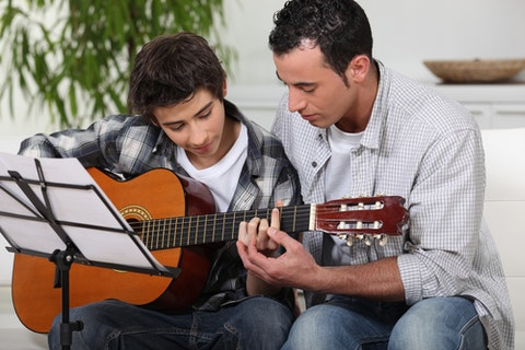 lesson, guitar, music, teaching, kid, father, learn, playing, child, son, boy, adult, youth, instrument, musician, young, guitarist, caring, fatherhood, two, fun, closeness, 10 Easiest Beginner Guitar Songs To Learn