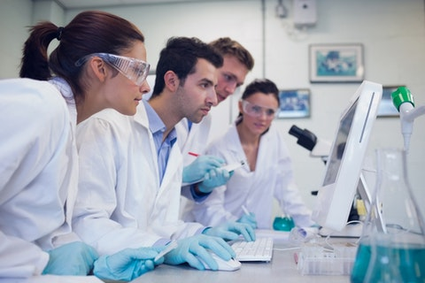 researching, researcher, research, medical, lab, health, electronic, technician, screen, specialist, woman, man, serious, studying, table, surgical glasses, practitioner, male,