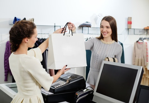 retail, worker, cashier, shop, counter, checkout, pay, paying, sale, business, buying, bag, payment, job, white, money, stylish, store, customer, cash, clothing, glamour,
