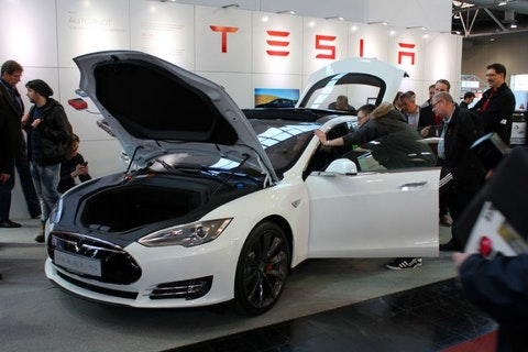 TSLA, backgrounds, car, cebit, decoration, electric, event, exhibition, expo, fame, germany, hall, hannover, horizontal, image, indoors, light, line, people, screen, shape, showing, square, tesla, view, white